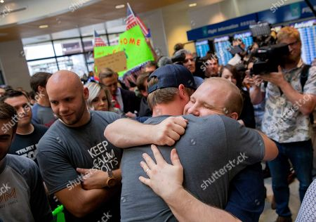 Stock Image of Josh Holt, right, is greeted by family and friends upon returning to Salt Lake City after receiving medical care and visiting President Donald Trump in Washington on . Holt was freed this weekend after being held in a Venezuelan jail for nearly two years