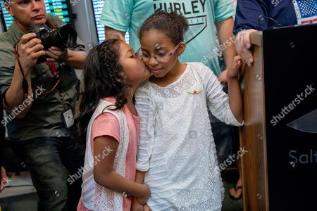 Josh Holt's daughter Marian, right, is kissed by Holt's stepdaughter Nathalia Carrasco during Marian and Josh's arrival in Salt Lake City after receiving medical care and visiting President Donald Trump in Washington, . Josh Holt and his wife were released over the weekend from a Venezuelan jail