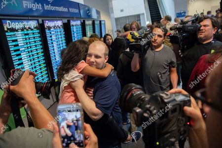 Josh Holt hugs his stepdaughter Nathalia Carrasco upon returning to Salt Lake City, . Holt and his wife were released from a Venezuelan jail over the weekend, after being imprisoned for nearly two years