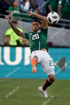 Mexico's Javier Aquino plays against Wales during the second half of their soccer match in Pasadena, Calif. The match ended in a 0-0 tie