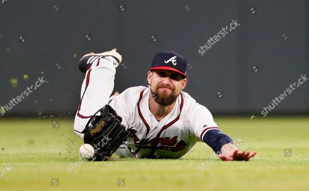 Atlanta Braves center fielder Ender Inciarte (11) can't catch a ball hit for a single by New York Mets' Adrian Gonzalez in the seventh inning of the second game of a baseball doubleheader, early, in Atlanta