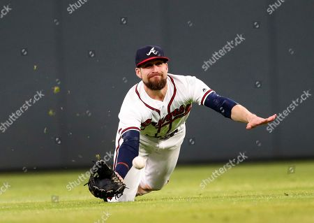 Atlanta Braves center fielder Ender Inciarte (11) can't catch a ball hit for a single by New York Mets' Adrian Gonzalez in the seventh inning of the second game of a baseball doubleheader, in Atlanta