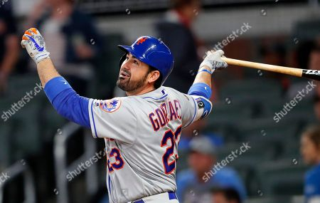 New York Mets first baseman Adrian Gonzalez (23) is shown in actin against the Atlanta Braves during a baseball game, in Atlanta