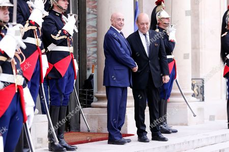 French Foreign Affairs Minister Jean-Yves Le Drian welcomes President of the Libyan House of Representatives in Tobruk Aguila Saleh Issa upon his arrival at the Elysee Palace for the international congress on Libya in Paris, France, 29 May 2018.