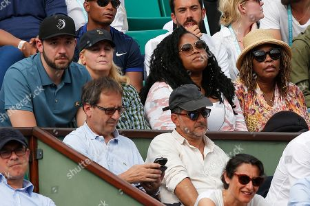 Serena Williams' husband Alex Ohanian, her agent Jill Smoller, her sister Isha, and her mother Oracene Price, from left to right, watch Serena play against Kristyna Pliskova of the Czech Republic during their first round match of the French Open tennis tournament at the Roland Garros stadium in Paris, France