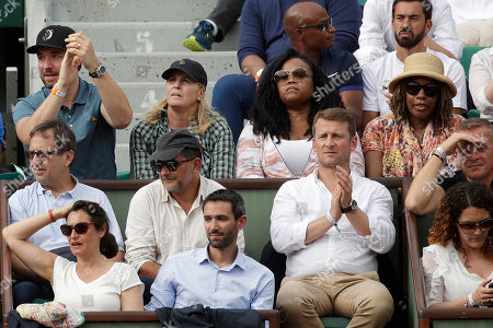 Serena Williams' husband Alex Ohanian, her agent Jill Smoller, her sister Isha, and her mother Oracene Price, middle row from left to right, watch Serena play against Kristyna Pliskova of the Czech Republic during their first round match of the French Open tennis tournament at the Roland Garros stadium in Paris, France