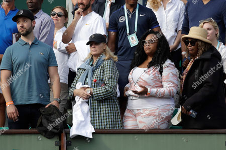 Serena Williams' husband Alex Ohanian, her agent Jill Smoller, her sister Isha, and her mother Oracene Price, from left to right, watch Serena celebrate her win against Kristyna Pliskova of the Czech Republic during their first round match of the French Open tennis tournament at the Roland Garros stadium in Paris, France
