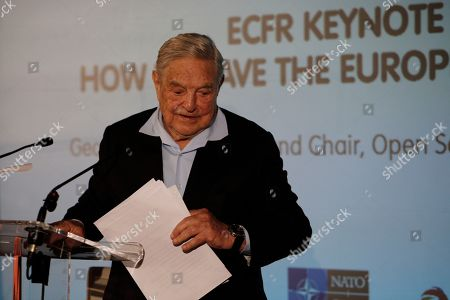 """George Soros, Founder and Chairman of the Open Society Foundations leaves after his speech entitled """"How to save the European Union"""" as he attends the European Council On Foreign Relations Annual Council Meeting in Paris"""