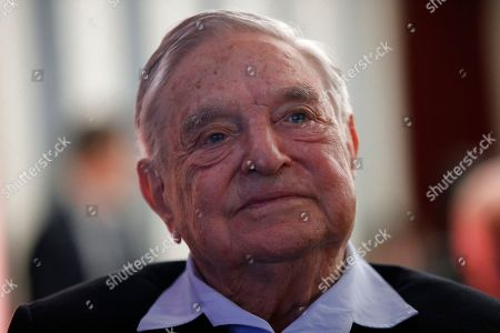 """George Soros, Founder and Chairman of the Open Society Foundations listens to the conference after his speech entitled """"How to save the European Union"""" as he attends the European Council On Foreign Relations Annual Council Meeting in Paris"""