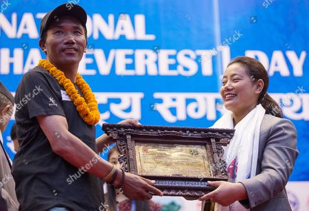 Nepalese Minister of water supply Bina Magar felicitates Kami Rita Sherpa, aged 48, with Tenzing Hillary Mountaineering Award during the function to mark the International Everest Day in Kathmadu, Nepal, 29 May 2018. Kami Rita, a professional mountaineer guide has successfully climbed Mount Everest 22 times, setting a new world record for climbing Mount Everest. Nepal is celebrating the 'International Everest Day' with various events on 29 May 2017 commemorating the first climb to the summit on 29 May 1953 by Sir Edmund Hillary and Tenzing Norgay Sherpa.