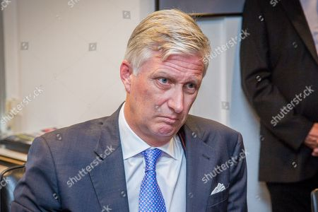 King Philippe of Belgium listen to the Mayor of Liege Willy Demeyer (not seen) at the town hall in Liege, Belgium, 29 May 2018. According to media reports, a gunman was shot dead by anti-terrorist police after reportedly killing two police officers and a passerby and injuring two others in the center of the Belgian city of Liege on 29 May. During a shootout the man was said to have entered a high school where he took hostage a female cleaner before being shot by the police. Authorities are investigating the incident and terrorism was not ruled out as a possible motive.