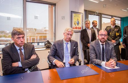 (L-R) Belgian Interior Minister Jan Jambon, King Philippe-Filip of Belgium  and Belgian Prime Minister Charles Michel listen to the Mayor of Liege Willy Demeyer (not seen) at the town hall in Liege, Belgium, 29 May 2018. According to media reports, a gunman was shot dead by anti-terrorist police after reportedly killing two police officers and a passerby and injuring two others in the center of the Belgian city of Liege on 29 May. During a shootout the man was said to have entered a high school where he took hostage a female cleaner before being shot by the police. Authorities are investigating the incident and terrorism was not ruled out as a possible motive.