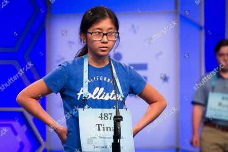 Tina Huang, 14, from North Tazewell, Va., spells her word correctly during the 2nd Round of the Scripps National Spelling Bee in Oxon Hill, Md