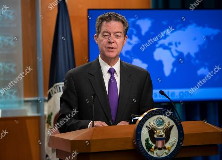 Ambassador-at-Large for International Religious Freedom Sam Brownback, speaks to reporters as he unveils the annual U.S. assessment of religious freedom around the world, at the State Department in Washington