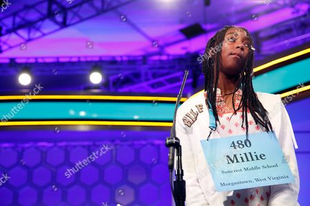 Millie Brown, 14, from Morgantown, W.Va., reacts after spelling her word correctly during the 2nd Round of the Scripps National Spelling Bee, in Oxon Hill, Md