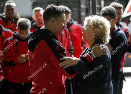 Manuela Carmena and (R), greets Rayo Vallecano's head coach Miguel Angel Sanchez 'Michel'
