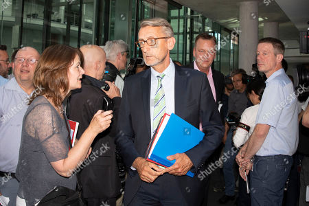 Armin Schuster (C) of the Christian Social Union (CSU), a member of Bundestag's committee on domestic affairs, arrives at a meeting of the German Bundestag's interior committee in Berlin, Germany, 29 May 2018. The committee met on the topic of unlawfully approved asylum applications by the Office for Migration and Refugees (Bundesamt fuer Migration und Fluechtlinge, BAMF). A former employee at the BAMF's regional Bremen branch may have issued positive answers to some 1,200 requests for asylum in Germany despite the Bremen office not being authorized to do so. Reports state three lawyers and two other persons may have organized the contacts to Bremen office from 2013 to 2016.