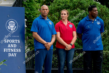 Mariano Rivera, Misty May-Treanor, Herschel Walker. From left, former New York Yankees baseball pitcher Mariano Rivera, retired professional beach volleyball player Misty May-Treanor, and former football player Herschel Walker, attend White House Sports and Fitness Day on the South Lawn of the White House, in Washington