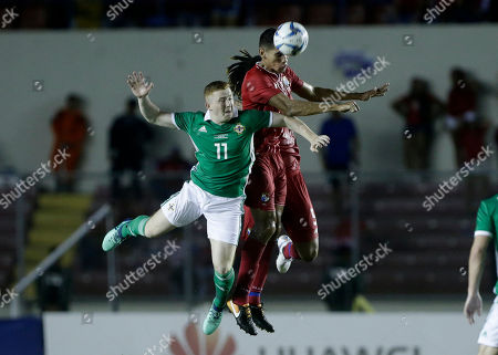 Stock Image of Panama's Valentin Pimentel, center, heads he ball pressures by Northern Ireland's Shayne Lavery, 11, during a friendly soccer match in Panama City
