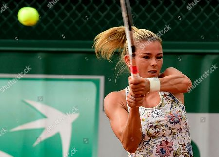 Camila Giorgi of Italy plays Mariana Duque-Marino of Colombia during their women?s second round match during the French Open tennis tournament at Roland Garros in Paris, France, 30 May 2018.