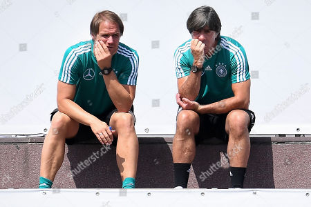 Germany's assistant coach Thomas Schneider (L) and head coach Joachim Loew (R) during a test match against Germany's U20 in Eppan, Italy, 30 May 2018. The German squad prepares for the upcoming FIFA World Cup 2018 soccer championship in Russia at a training camp in Eppan, South Tyrol, until 07 June 2018.