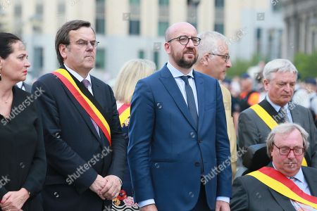 Belgian Prime Minister Charles Michel (C) and Leige City Mayor Willy Demeyer (2-L) together with police officers take part in a minute of silence for the victims of the shooting that took place a day earlier, in Liege, Belgium, 30 May 2018. On 29 May, a gunman was shot dead by anti-terrorist police after reportedly killing two police officers and a passerby and injuring two others in the center of the Belgian city of Liege. During a shootout the man was said to have entered a high school where he took a female cleaner hostage before being shot by the police.