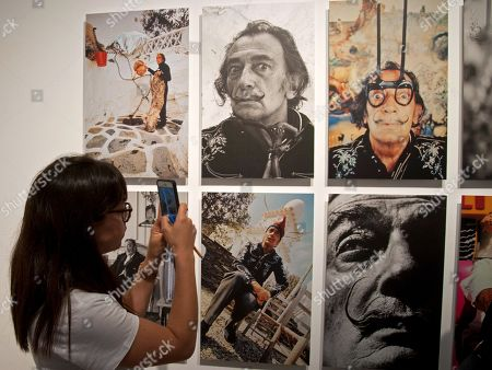 A woman takes photos of portraits of Spanish artist Salvador Dali during the presentation of a photo exhibition of British photographer Robert Whitaker at the Theatre-Museum in Figueres, Spain, 30 May 2018. The exhibition titled 'Salvador Dali. Robert Whitaker. 1967-1972' features 27 portraits of Dali made in the village of Porlligat and Paris.