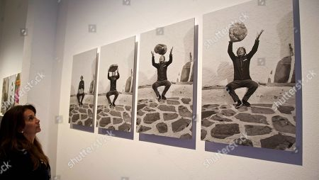 A woman looks at portraits of Spanish artist Salvador Dali during the presentation of a photo exhibition of British photographer Robert Whitaker at the Theatre-Museum in Figueres, Spain, 30 May 2018. The exhibition titled 'Salvador Dali. Robert Whitaker. 1967-1972' features 27 portraits of Dali made in the village of Porlligat and Paris.