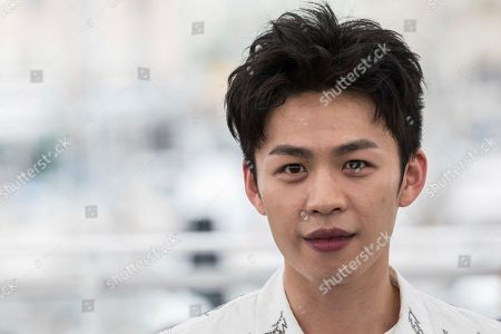 Lee Hong-Chi poses for photographers during a photo call for the film 'Long Day's Journey Into Night' at the 71st international film festival, Cannes, southern France