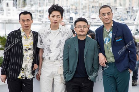 Yongzhong Chen, Huang Jue, Gan Bi, Jue Huang. Yongzhong Chen, Huang Jue, Gan Bi and Jue Huang pose for photographers during a photo call for the film 'Long Day's Journey Into Night' at the 71st international film festival, Cannes, southern France