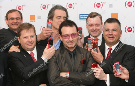 (l-r) Andy Dewhurst Charles Dunsmore Bobby Shriver Bono Mike Newington Ron Garnques Launch The New Motorola Moto (red) At The Carphone Warehouse Oxford St London. (product)red Is Designed To Deliver A Sustainable Flow Of Private Sector Money To The Global Fund To Fight Aids.