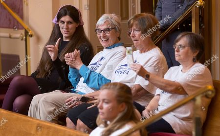 Stock Picture of Del. Danica Roem, D-Prince William, left, talks with supporters of Medicaid expansion as they celebrate a vote in the gallery of the Virginia Senate at the Capitol in Richmond, Va