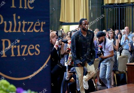 """Pulitzer Prize winner for music Kendrick Lamar walks onto the stage to accept his award for his album """"DAMN,"""" during the 2018 Pulitzer Prize awards luncheon at Columbia University, in New York"""