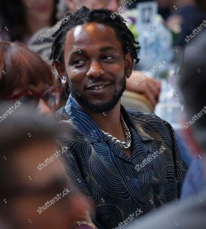 """Rapper-songwriter Kendrick Lamar sits before accepting his Pulitzer Prize for music award for the album """"DAMN,"""" during the 2018 Pulitzer Prize awards luncheon at Columbia University, in New York"""