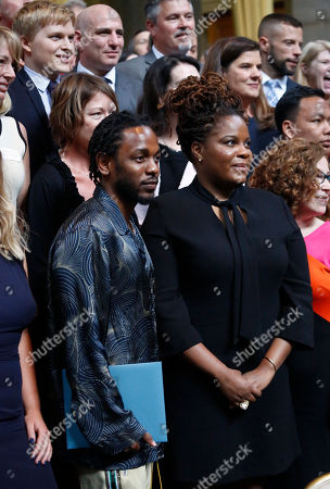 Lamar, Ghansah. Pulitzer Prize winner for music Kendrick Lamar, left front, stands next to the winner for feature writing GQ freelancer Rachel Kaadzi Ghansah, during a group photo of 2018 winners after their awards ceremony at Columbia University, in New York