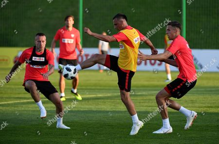 Polish national soccer team players Jacek Goralski (L), Slawomir Peszko (C) and Jan Bednarek (R) attend a training session in Arlamow, Poland, 30 May 2018. Poland prepares for the FIFA World Cup 2018 taking place in Russia from 14 June until 15 July 2018.
