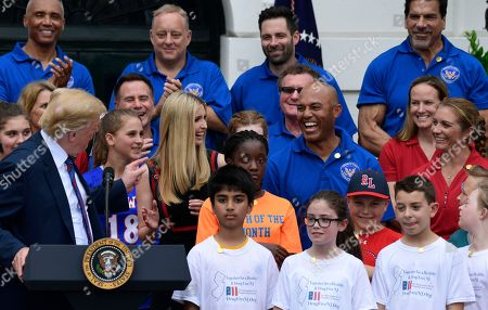 Stock Picture of Donald Trump, Mariano Rivera, Misty May-Treanor, Lou Ferrigno. President Donald Trump, left, talks about former New York Yankees relief pitcher Mariano Rivera, third from middle right, during the White House Sports and Fitness Day event on the South Lawn of the White House in Washington, . Ivanka Trump, beach volleyball star Misty May-Treanor, middle right, and Lou Ferrigno, top right, listen