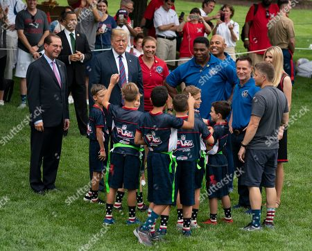 United States president Donald Trump, Misty May-Treanor and Herschel Walker chat with kids attending the White House Sports and Fitness Day at the White House