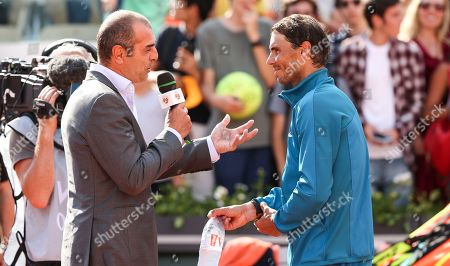Stock Image of Former player Cedric Pioline interviews Rafa Nadal (ESP) after his win against Guido Pella (ARG)