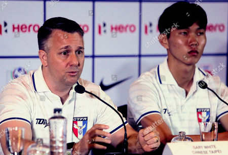 Taiwan's soccer coach Gary White speaks with captain Tu Shao-Chieh by his side during a pre-tournament press conference for the Hero Intercontinental Cup in Mumbai, India, . The soccer tournament will begin June 1