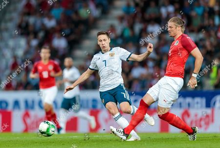 Stock Photo of Russia's Daler Kuzyayev (L) and Austria's Sebastian Proedl in action during the international friendly soccer match between Austria and Russia at Tivoli Stadium in Innsbruck, Austria, 30 May 2018.