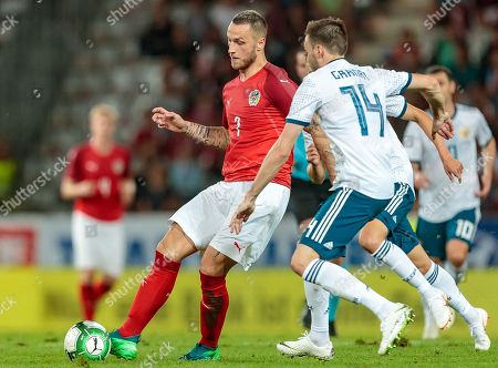Austria's Marko Arnautovic (L) and Russia's Vladimir Granat (R) in action during the international friendly soccer match between Austria and Russia at Tivoli Stadium in Innsbruck, Austria, 30 May 2018.