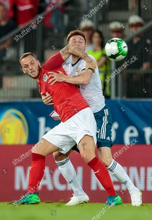 Austria's Marko Arnautovic (L) and Russia's Vladimir Granat in action during the international friendly soccer match between Austria and Russia at Tivoli Stadium in Innsbruck, Austria, 30 May 2018.
