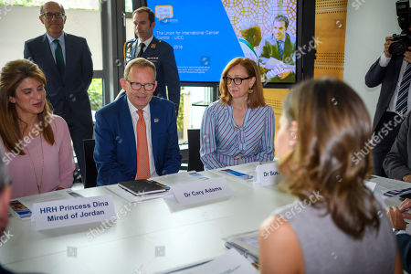 Stock Picture of Spain's Queen Letizia, right, HRH Princess Dina Mired of Jordan President-elect of UICC, left, and Cary Adams, center, Chief Executive Officer UICC, speak, during a queen's visit at the headquarters of the Union for International Cancer Control (UICC) in Geneva, Switzerland, 31 May 2018.