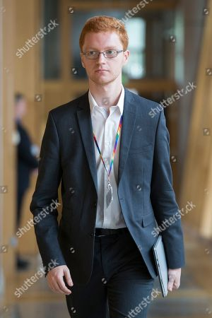Scottish Parliament First Minister's Questions - Ross Greer makes his way to the Debating Chamber.