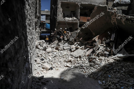 Syrian firefighters and civil defense personnel work at the site of explosion at a building in the town of Ariha, Idlib province, Syria, 31 May 2018. According to local reports, three people were killed in an explosion that destroyed a multi-sotrey building in Ariha town of Idlib. The reason of the explosion is still unknown.