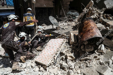 Stock Picture of Syrian firefighters and civil defense personnel work at the site of explosion at a building in the town of Ariha, Idlib province, Syria, 31 May 2018. According to local reports, three people were killed in an explosion that destroyed a multi-sotrey building in Ariha town of Idlib. The reason of the explosion is still unknown.