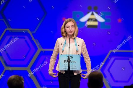 Phoebe Smith, 12, from Aston, Pa., spells her word incorrectly during the evening finals of the Scripps National Spelling Bee in Oxon Hill, Md