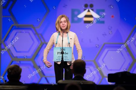 Phoebe Smith, 12, from Aston, Pa., spells her word correctly during the Finals of the Scripps National Spelling Bee in Oxon Hill, Md
