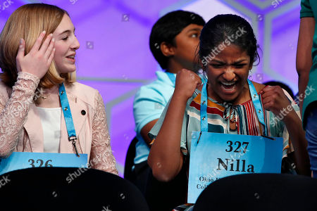 Phoebe Smith, Nilla Rajan. Phoebe Smith, 12, from Aston, Pa., left, and Nilla Rajan, 13, from Chillicothe, Ohio, celebrate as a competitor spells her word correctly in the Scripps National Spelling Bee in Oxon Hill, Md